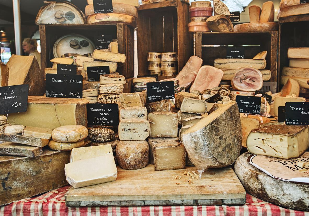 Sample French cheese at the market