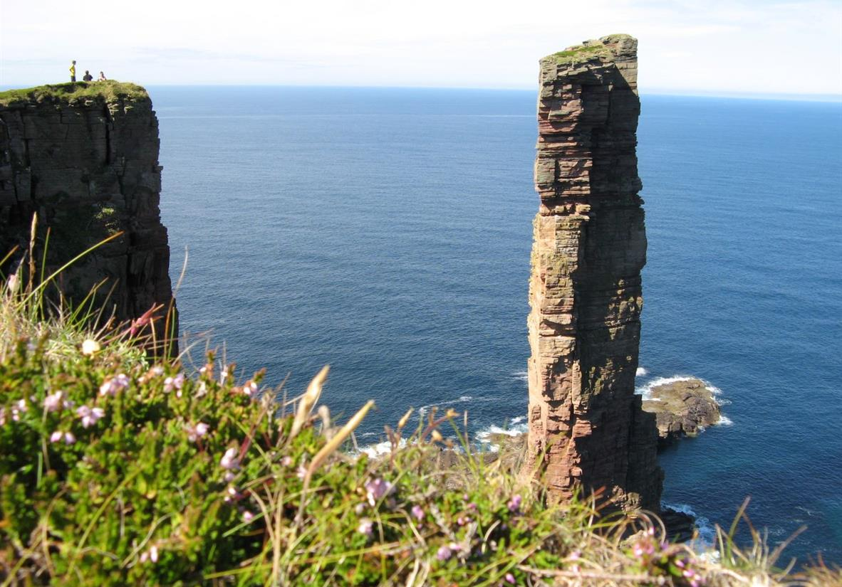 Hikers overlooking the Old Man of Hoy sea stack