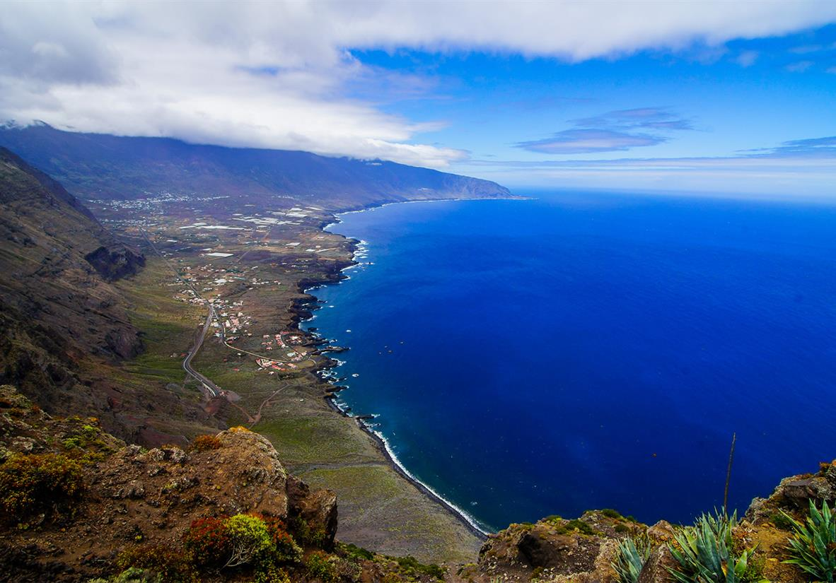 Deep blue waves crashing onto El Hierro's coast